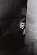 Teenager standing on spiral stairwell, Essex, UK, 1983