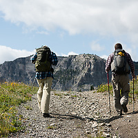hikers on trail over white rock pass, badger two medicine area, rocky mountain front, montana.