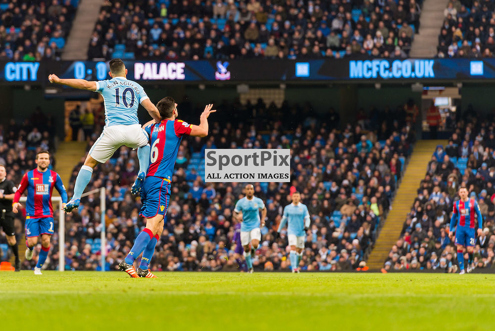 Manchester City forward Sergio Aguero (10) rises above Crystal Palace defender Scott Dann (6)