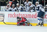 KELOWNA, CANADA - NOVEMBER 24:  Ryan Graham #39 of the  Saskatoon Blades checks Jesse Lees #2 of the Kelowna Rockets to the ice at the Kelowna Rockets on November 24, 2012 at Prospera Place in Kelowna, British Columbia, Canada (Photo by Marissa Baecker/Shoot the Breeze) *** Local Caption ***
