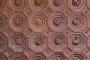 Wooden coffered ceiling with 75 octagonal panels, made 1541-43 by Sebastian de Segovia during the reign of Emperor Charles V, in the Salon del Techo de Carlos V, or Charles V Ceiling Room, in the Mudejar Palace, or Palacio del Rey Don Pedro, built by Pedro I of Castile, 1334-1369, in 1364, in the Real Alcazar, a Moorish royal palace in Seville, Andalusia, Spain. The ceiling is made from pine wood with ground colour pigments, and the panels are carved with floral designs and busts. The Alcazar was first founded as a fort in 913, then developed as a palace in the 11th, 12th and 13th centuries and used by both Muslim and Christian rulers. The Alcazar is listed as a UNESCO World Heritage Site. Picture by Manuel Cohen