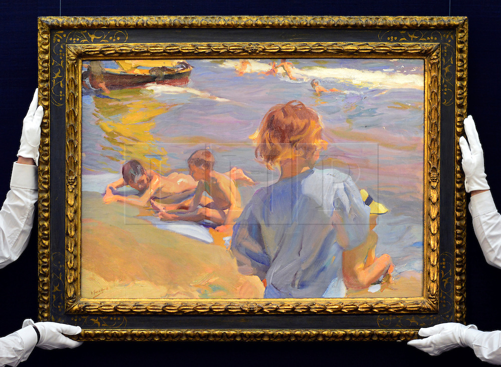 © Licensed to London News Pictures. 17/05/2013. London, UK JOAQUÍN SOROLLA, SPANISH, 1863 - 1923.NIÑOS EN LA PLAYA, VALENCIA (CHILDREN ON THE BEACH, VALENCIA) Estimate: 1,800,000 - 2,500,000 GBP A photo call for a preview of 19th Century European Paintings held at Sotheby's London today 17th May 2013. The paintings will be offered to auction on 23 May 2013. Photo credit : Stephen Simpson/LNP