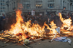 © under license to London News Pictures. 26/03/201. People surround a burning wooden horse on Oxford Circus in London. Hundreds of thousands of people take to the streets of London to protest against the Coalition Government cuts. Organised by the TUC the 'March for the Alternative' is the largest in London since the anti Iraq war protests. Photo credit should readMichael Graae/LNP.