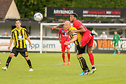 Vadaine Oliver battles with Harrogate Town skipper Danny Ellis during the Friendly match between Harrogate Town and York City at Wetherby Road, Harrogate, United Kingdom on 25 July 2015. Photo by Simon Davies.