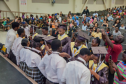 The graduates present ties to the Class of 2017 as  part of a tradition marking their rise to seniors.  St. Thomas/St. John Seventh Day Adventist School Commencement Service.  Bertha C. Boschulte Auditorium.  St. Thomas, USVI.  12 June 2016.  © Aisha-Zakiya Boyd