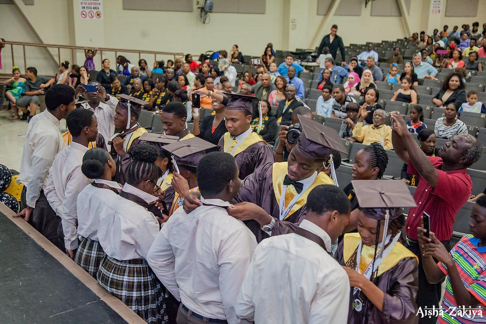 The graduates present ties to the Class of 2017 as  part of a tradition marking their rise to seniors.  St. Thomas/St. John Seventh Day Adventist School Commencement Service.  Bertha C. Boschulte Auditorium.  St. Thomas, USVI.  12 June 2016.  © Aisha-Zakiya Boyd