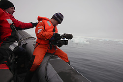 USA ALASKA CHUKCHI SEA 29JUL12 - Videographer Adams Wood of the USA and Greenpeace boat crew survey the sea ice in the Chukchi Sea near a proposed Shell drill site north of Point Hope, Alaska...Photo by Jiri Rezac / Greenpeace....© Jiri Rezac / Greenpeace