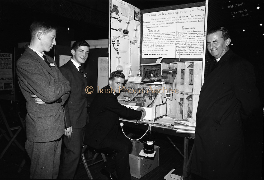 5/1/66.1/5/66.5th January 1966   .Aer Lingus Young Scientist Exhibition.RDS, Dublin..The second Young Scientist Exhibition , sponsored by Aer Lingus is being held in the RDS show grounds Dublin from the 5th to 7th January 1966. The picture shows some Cork Exhibitions photographed, shown is Eamonn McCarthy's Exhibit. (L-R) Breandan Buckley (St. Finbarrs College Cork, who is exhibiting in the Junior Boys Biochemistry section 'An Examination of Blood') Fachtna O'Ciardha (from St. Finbarrs College Cork who is exhibiting an Investigation of Bacteriological Process in Milk) Eamonn McCarthy (St. Finbarrs College, who's exhibit shows the Tracing of Nutrient Elements in Plants) and Rev. C. McCarthy Principal of St. Finbarrs College Cork