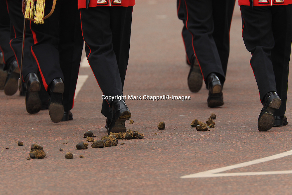London, UNITED KINGDOM. June 05 2012. Guardsmen march through fresh horse droppings without swerving during the set up for HM The Queen's Diamond Jubilee Parade.<br /> Photo Credit: Mark Chappell/i-Images<br /> &copy; Mark Chappell/i-Images 2012. All Rights Reserved. See instructions