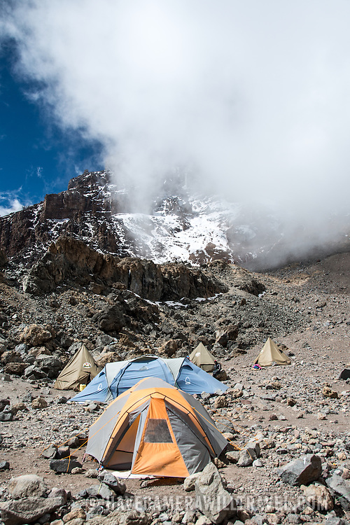 Tents at Arrow Glacier Camp with the Western Breach in the background on Mt Kilimanjaro's Lemosho Route.