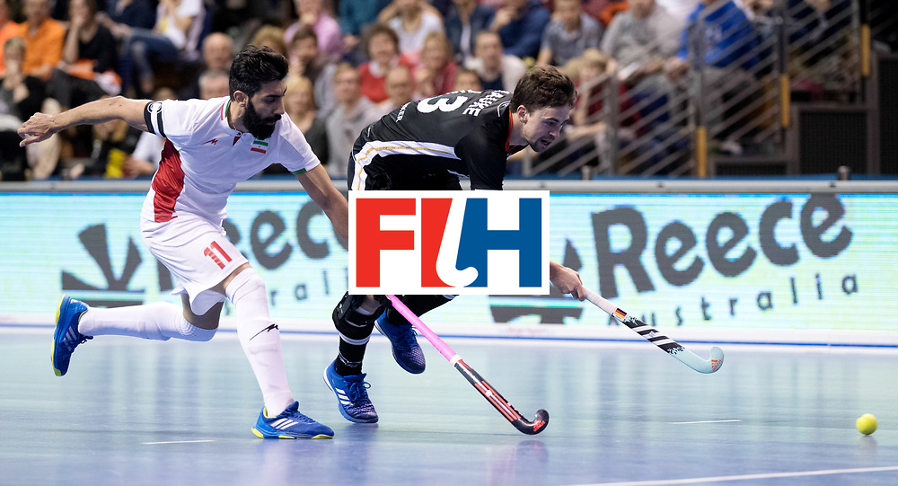 BERLIN - Indoor Hockey World Cup<br /> Semi-final 1: Germany - Iran<br /> foto: Tobias Hauke and BEIRANVAND Behdad.<br /> WORLDSPORTPICS COPYRIGHT FRANK UIJLENBROEK