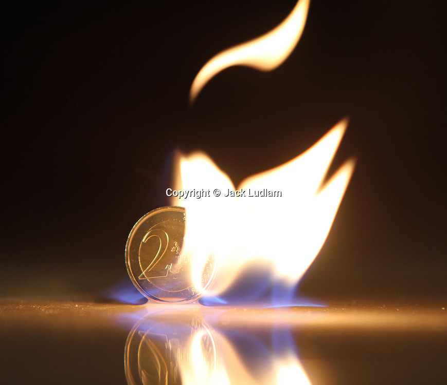 2 Euro coin in flames, Fire Swan,Natural. (not digitally altered)