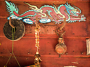 16 OCTOBER 2015 - BANGKOK, THAILAND:  A Chinese style dragon over the door of a small shop in the Wat Kalayanamit neighborhood. The shop owner is being evicted. Fifty-four homes around Wat Kalayanamit, a historic Buddhist temple on the Chao Phraya River in the Thonburi section of Bangkok, are being razed and the residents evicted to make way for new development at the temple. The abbot of the temple said he was evicting the residents, who have lived on the temple grounds for generations, because their homes are unsafe and because he wants to improve the temple grounds. The evictions are a part of a Bangkok trend, especially along the Chao Phraya River and BTS light rail lines. Low income people are being evicted from their long time homes to make way for urban renewal.   PHOTO BY JACK KURTZ