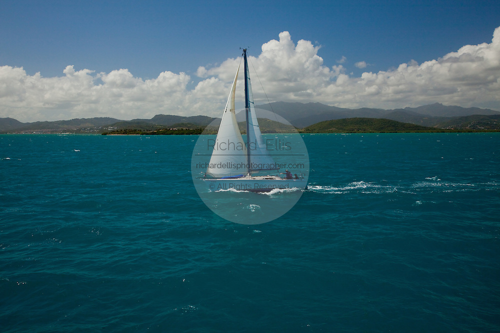 A sailboat crosses from Puerto Rico to the Caribbean Island of Vieques, Puerto Rico (photo by Charleston SC photographer Richard Ellis)