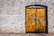 Detail of abandoned storefront on SE Market St, in downtown Reidsville, NC.