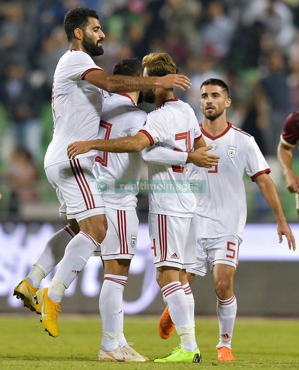 Ali Golizadeh (2-R) of Iran celebrates with his team mates after scoring the first goal against Venezuela during international friendly soccer match between Iran and Venezuela at Al Ahli Stadium Doha, Capital of Qatar, November 20, 2018. The match ended with a 1-1 draw. (Credit Image: © Nikku/Xinhua via ZUMA Wire)