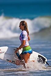 HUNTINGTON BEACH, CA - JULY 19: Alana Blanchard (USA) -- walks off the water after finishing fourth place at the Hurley US Open of Surfing 2009 Nike 6.0 Pro Semi-finals Heat 2. Photo: Eduardo E. Silva