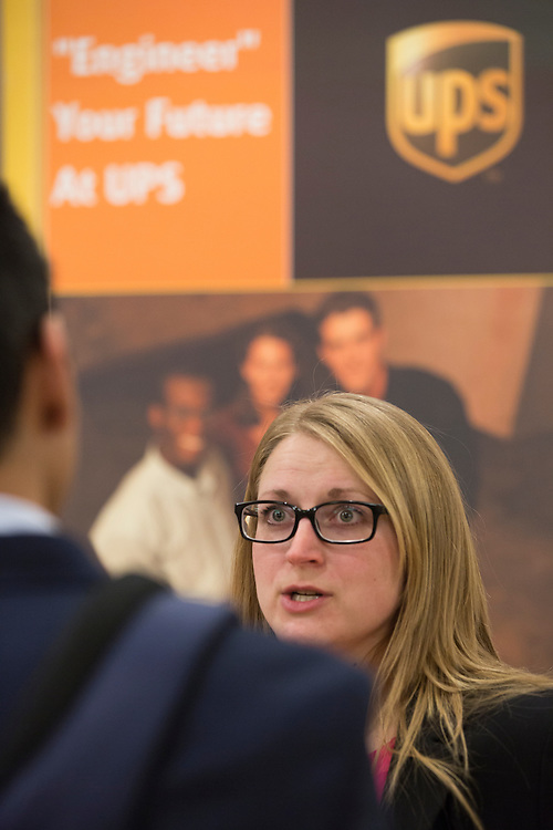Ashley Manella, a representative with UPS, talks to students about work opportunities with UPS at the Institute of Industrial and Systems Engineering Regional Conference in Baker Center on Feb. 25, 2017.