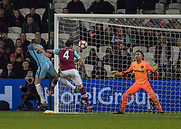 Football - 2016 / 2017 FA Cup - Third Round: West Ham United vs. Manchester City <br /> <br /> John Stones of Manchester City guides the ball past Adrian of West Ham for Manchester City's 5th goal at The London Stadium.<br /> <br /> COLORSPORT/DANIEL BEARHAM