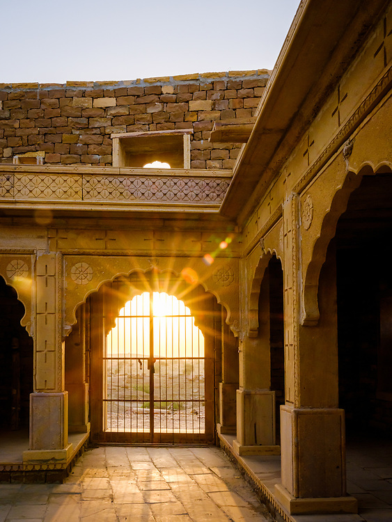 """JAISALMER, INDIA - CIRCA NOVEMBER 2018: View Khabha Fort, outside Jaisalmer city. Jaisalmer is also called """"The Golden City, and it is located in Rajasthan.  The town stands on a ridge of yellowish sandstone, and is crowned by the ancient Jaisalmer Fort."""