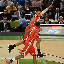 Mar 31, 2012; New Orleans, LA, USA; Ohio State Buckeyes forward Jared Sullinger (0) reacts while running along side with forward Deshaun Thomas (1) during the first half in the semifinals of the 2012 NCAA men's basketball Final Four against the Kansas Jayhawks at the Mercedes-Benz Superdome. Mandatory Credit: Derick E. Hingle-US PRESSWIRE