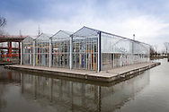 "Europe, The Netherlands, South Holland, Naaldwijk, the floating greenhouse De Drijvende Kas on a pond of the FloraHolland branch in Naaldwijk, this greenhouse was used as a feasibility study for the project ""Floating Rose"", a 45,000 square meter large block of greenhouses that could be built on waters for rose production...Europa, Niederlande, Suedholland, Naaldwijk, schwimmndes Gewaechshaus De Drijvende Kas auf einem Teich der FloraHolland-Niederlassung Naaldwijk, dieses Gewaechshaus diente als Machbarkeitsstudie fuer das Projekt Floating Roses, ein 45.000 Quadratmeter grosser Gewaechshausblock, der auf einem Gewaesser zur Rosenproduktion errichtet werden koennte."