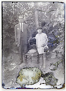 severely eroding glass plate photo with father and young girl