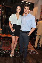 Actors MADELEINE MANTOCK and  JACK DERGES at the opening of the new Jack Spade store at 83 Brewer street, London on 29th March 2012.