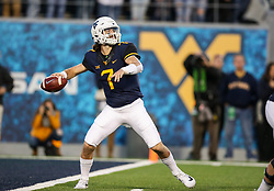 Nov 4, 2017; Morgantown, WV, USA; West Virginia Mountaineers quarterback Will Grier (7) throws a pass during the fourth quarter against the Iowa State Cyclones at Milan Puskar Stadium. Mandatory Credit: Ben Queen-USA TODAY Sports