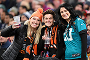 Three ladies supporting the Bengals during the International Series match between Los Angeles Rams and Cincinnati Bengals at Wembley Stadium, London, England on 27 October 2019.