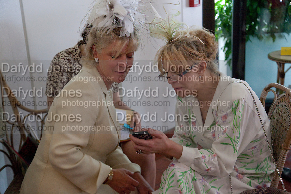 THE COUNTESS OF MARCH; COURTNEY LOVE IN THE DUKE OF RICHMOND BOX, Glorious Goodwood. Ladies Day. 28 July 2011. <br /> <br />  , -DO NOT ARCHIVE-© Copyright Photograph by Dafydd Jones. 248 Clapham Rd. London SW9 0PZ. Tel 0207 820 0771. www.dafjones.com.
