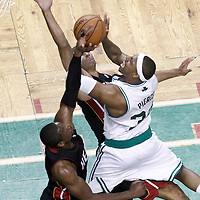 03 June 2012: Boston Celtics small forward Paul Pierce (34) goes to the basket over Miami Heat small forward Shane Battier (31) and Miami Heat shooting guard Dwyane Wade (3) during the first quarter of Game 4 of the Eastern Conference Finals playoff series, Heat at Celtics, at the TD Banknorth Garden, Boston, Massachusetts, USA.