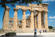 Tourists photograph ruins of ancient temples at Selinunte in Sicily, Italy - the largest archeological park in Europe.