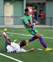 06 June 2015. New Orleans, Louisiana.<br /> National Premier Soccer League. NPSL. <br /> Ryan Reid of the New Orleans Jesters goes up against Samuel Goni of  Chattanooga FC in a Conference game at home in the Pan American Stadium. Chattanooga take a 4-0 victory over the Jesters.<br /> Photo; Charlie Varley/varleypix.com