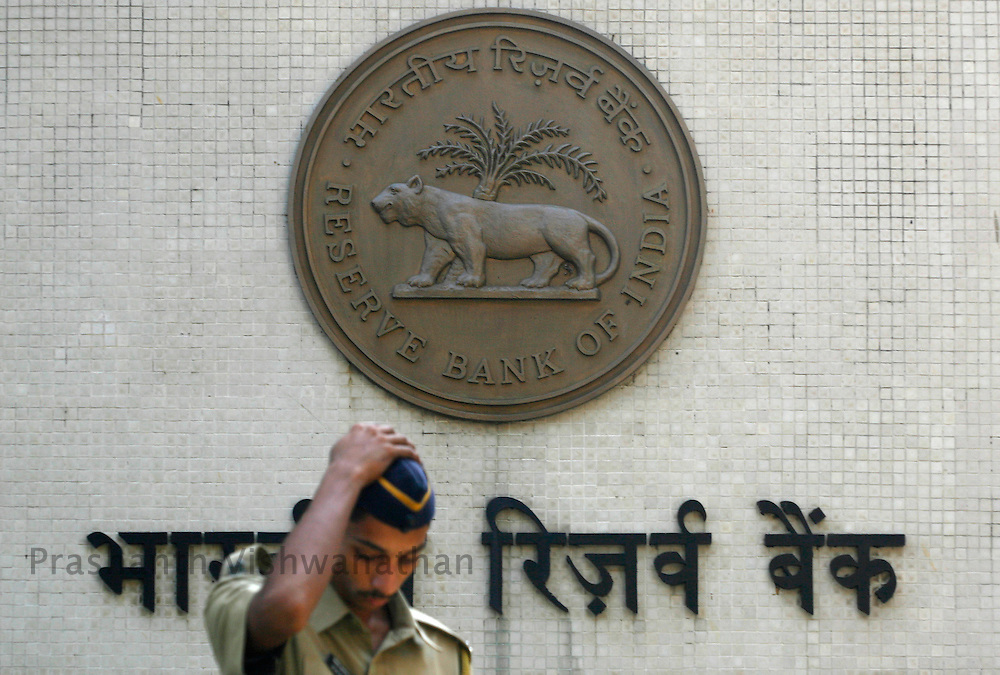 A guard stands outside the    Reserve    Bank     of    India building,  in Mumbai, India, on Tuesday, October 30, 2007. Photographer: Prashanth Vishwanathan/Bloomberg News