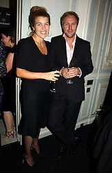AMBER NUTTALL and SIMON MILLS at a party hosted by Ruinart Champagne at Claridges, Brook Street, London on 18th October 2006.<br />