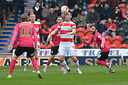 Luke McCullough (4) of Doncaster Rovers during the Sky Bet League 1 match between Doncaster Rovers and Peterborough United at the Keepmoat Stadium, Doncaster, England on 19 March 2016. Photo by Ian Lyall.