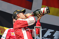 26.07.2015, Hungaroring, Budapest, HUN, FIA, Formel 1, Grand Prix von Ungarn, das Rennen, im Bild Sebastian Vettel (Scuderia Ferrari) trinkt aus der Sektflasche // during the race of the Hungarian Formula One Grand Prix at the Hungaroring in Budapest, Hungary on 2015/07/26. EXPA Pictures &copy; 2015, PhotoCredit: EXPA/ Eibner-Pressefoto/ Bermel<br /> <br /> *****ATTENTION - OUT of GER*****