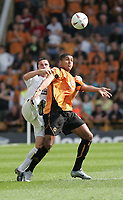 Photo:  Frances Leader.<br /> Wolverhampton Wanderers FC v Leeds United. The Coca-Cola Championship Molineux Stadium.<br /> 14/08/2004<br /> Wolves' Leon Clarke battles it out with Leeds' Gary Kelly.