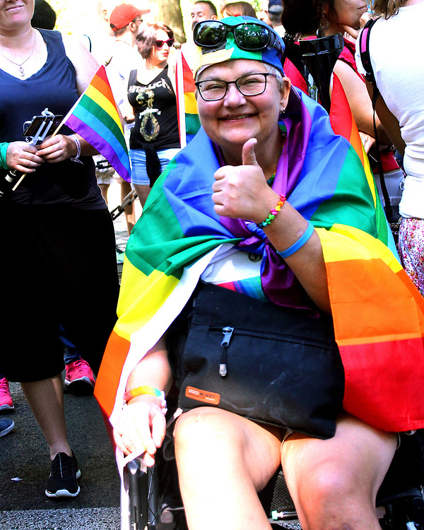 User with a wheelchair in the gay parade of Madrid ONLY EDITORIAL