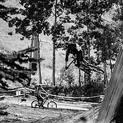 Jake Hawkes gets air off one of the features in bike skills area of Grand Targhee Resort, Wyoming.