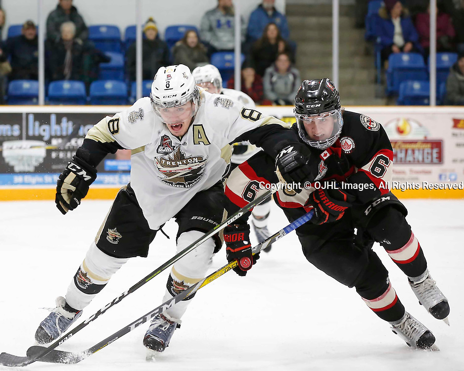 TRENTON, ON - MAR 3,  2017: Ontario Junior Hockey League, playoff game between the Trenton Golden Hawks and the Newmarket Hurricanes., Liam Morgan #8 of the Trenton Golden Hawks and Quinn Yule #8 of the Newmarket Hurricanes battle for the puck<br /> (Photo by Amy Deroche / OJHL Images)