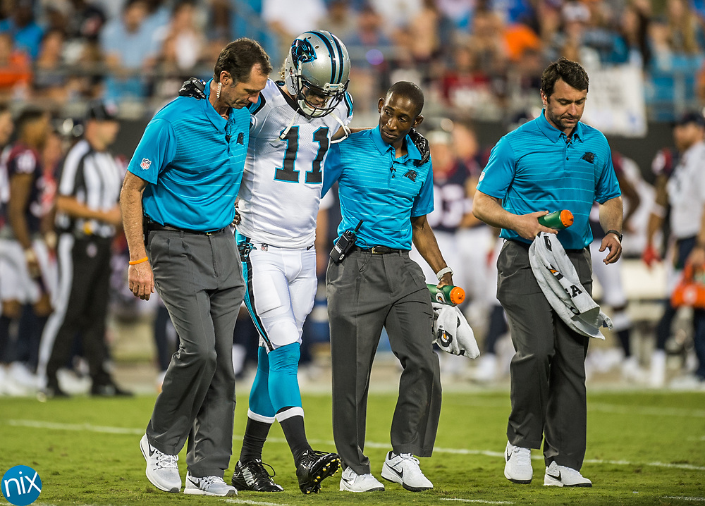 Carolina Panther Brenton Bersin is walked off the field by training staff during agame  against the Houston Texans during their first preseason game at Bank of American Stadium on Wednesday, August 9, 2017 in Charlotte, NC.