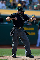 OAKLAND, CA - APRIL 11:  MLB umpire Mark Carlson #6 calls a third strike during the eleventh inning between the Oakland Athletics and the Seattle Mariners at O.co Coliseum on April 11, 2015 in Oakland, California. The Seattle Mariners defeated the Oakland Athletics 5-4 in 11 innings. (Photo by Jason O. Watson/Getty Images) *** Local Caption *** Mark Carlson