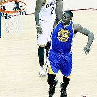 08 June 2016: Golden State Warriors forward Draymond Green (23) goes for the dunk following a foul past Cleveland Cavaliers guard Kyrie Irving (2) during the Cleveland Cavaliers 120-90 victory over the Golden State Warriors, during Game Three of the 2016 NBA Finals at the Quicken Loans Arena, Cleveland, Ohio, USA.