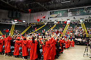 Students toss their caps during the Franklin High School graduation exercise at the Nutter Center in Fairborn, Saturday, May 26, 2012.