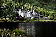 General view of Kylemore Abbey, 1867, by James Franklin Fuller and Samuel Ussher Roberts, Connemara, Ireland, in the evening. Kylemore Abbey, founded in 1920 for Benedictine Nuns who fled Belgium during World War I, was originally a private castle built on the shore of Lough Pollacappul for Mitchell and Margaret Henry, a wealthy couple from Manchester. The name Kylemore derives from the Irish Coill Mhor, or Great Wood. Picture by Manuel Cohen
