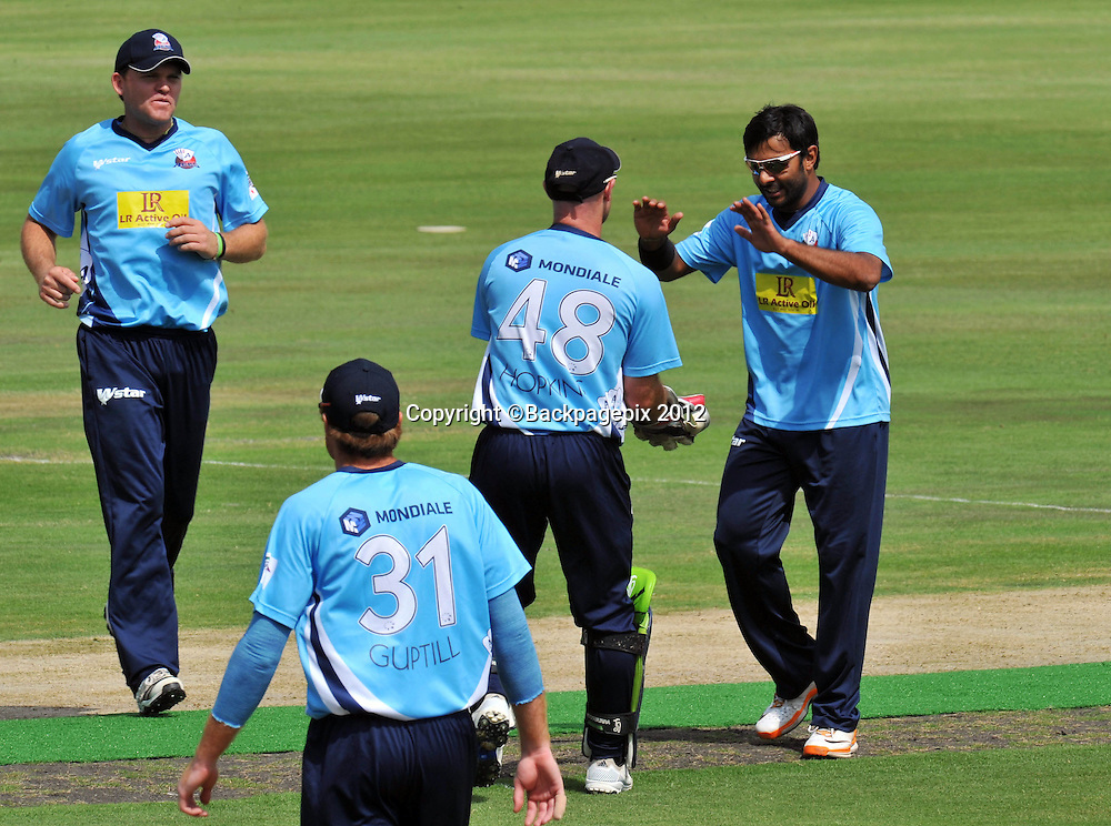 Ronnie Hira of Auckland Aces celebrates with his teammates after taking the wicket of Simon Katich of Perth Scorchers during the 2012 Champions League Twenty20 cricket match between the Perth Scorchers and the Auckland Aces at Supersport Park in Centurion, South Africa on 23 October 2012 ©Chris Ricco/BackpagePix