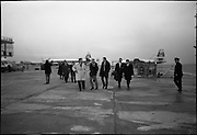 Irish Rugby Team Departs For France..1966..29.01.1966..01.29.1966..29th January 1966..The Irish rugby team departed Dublin Airport today for Saturday's meeting with France in Paris...Some of the players and officials are pictured strolling across the tarmac on the way to board the aircraft to Paris for the upcoming international.