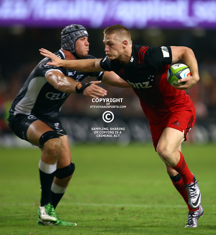 DURBAN, SOUTH AFRICA - MARCH 26: Nemani Nadolo of the BNZ Crusaders hands off  Stephan Lewies of the Cell C Sharks during the Super Rugby match between Cell C Sharks and BNZ Crusaders at Growthpoint Kings Park on March 26, 2016 in Durban, South Africa. (Photo by Steve Haag/Gallo Images)